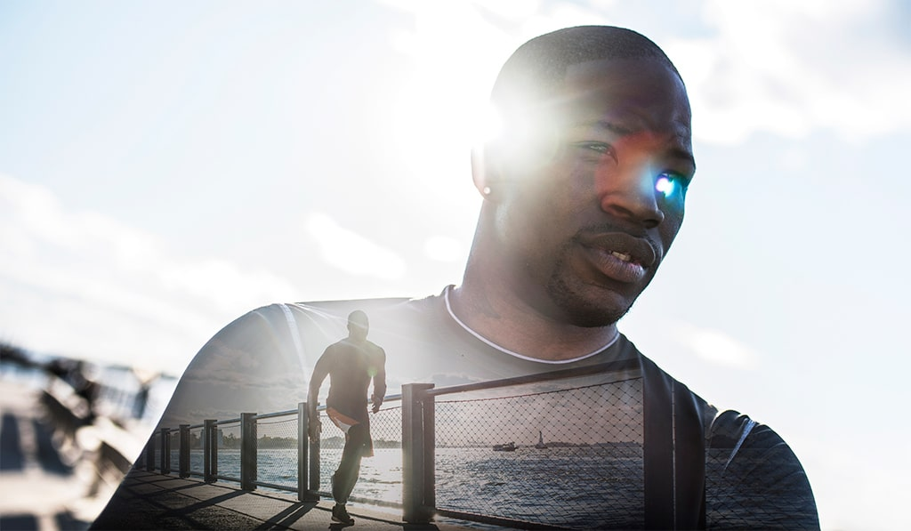 S2 Method Portrait of young man. He is wearing sports clothing. Blue sky in the back. Combined with an image of same man running. Double exposure.